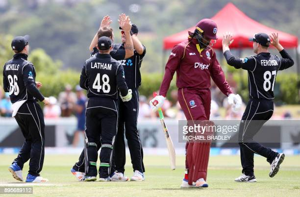 New Zealand celebrate as Chris Gayle of the West Indies is dismissed during the first ODI cricket match between New Zealand and the West Indies at...