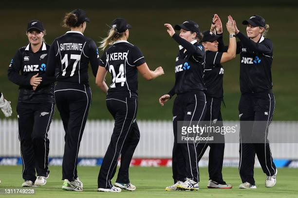 New Zealand celebrate taking the wicket of Meg Lanning, captain of Australia during game three of the One Day International series between the New...