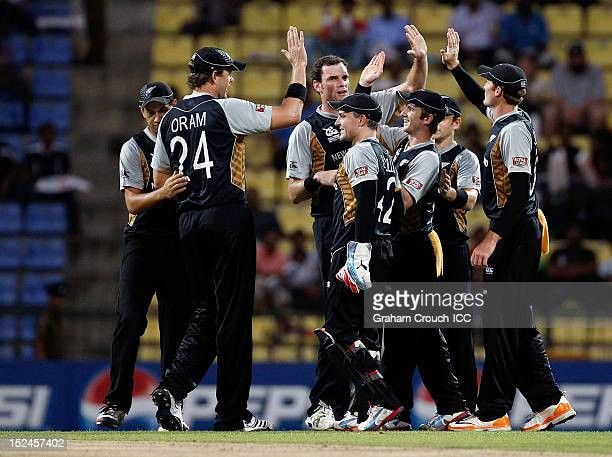 New Zealand celebrate the wicket of Shakib Al Hasan of Bangladesh during the ICC World T20 Group D match between New Zealand and Bangladesh at...