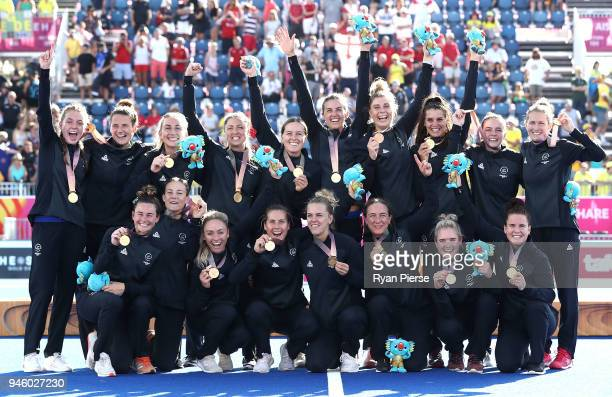 New Zealand celebrate with their Gold Medals after the Women's Gold Medal match between Australia and New Zealand during Hockey on day 10 of the Gold...