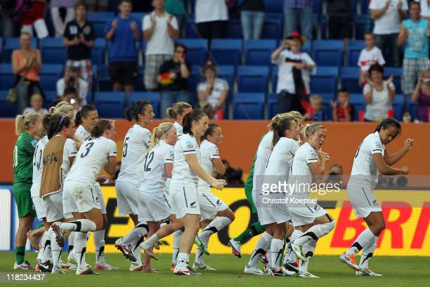 New Zealand celebrates after the 22 draw of the FIFA Women's World Cup 2011 Group B match between New Zealand and Mexico at RheinNeckar Arena on July...