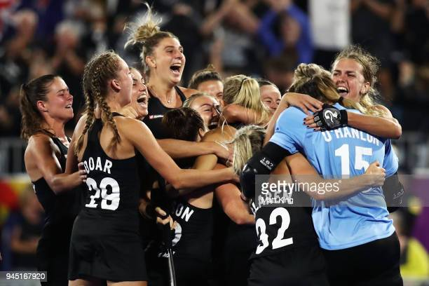 New Zealand celebrates victory after scoring last in the penalty shoot out during Women's Semi Final Hockey match between England and New Zealand on...