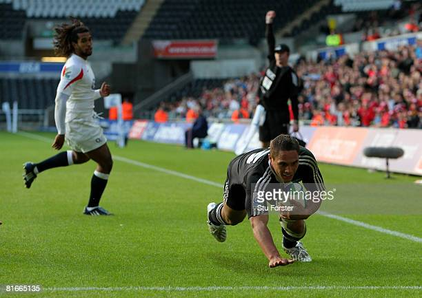 New Zealand centre Jackson Willison crosses the line to score during the IRB Junior World Championship Final game between New Zealand and England at...