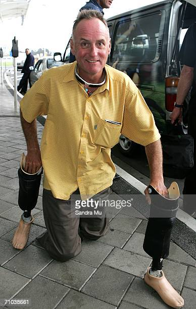 New Zealand climber Mark Inglis a doubleamputee makes his way to his car upon arriving at Auckland International airport after returning from...