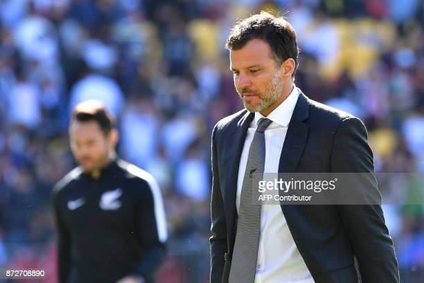 New Zealand coach Anthony Hudson walks from the field at halftime during the World Cup football qualifying match between New Zealand and Peru at...