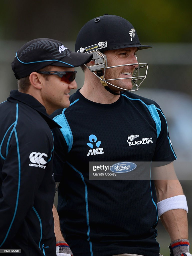 New Zealand coach Mike Hesson speaks with captain Brendon McCullum during an nets session at the University Oval on March 5, 2013 in Dunedin, New Zealand.