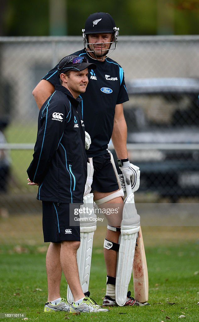 New Zealand coach Mike Hesson speaks with Peter Fulton during an nets session at the University Oval on March 5, 2013 in Dunedin, New Zealand.