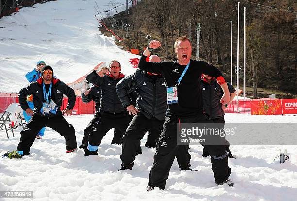 New Zealand coach Peter Sanford leads a Haka for silver medalist Corey Peters of New Zealand after the Men's Giant Slalom Sitting during day eight of...