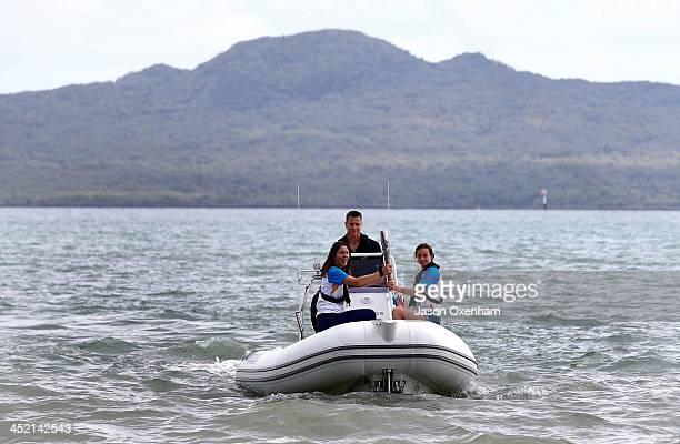 New Zealand Commonwealth Games athletes Joelle King and Nikki Hamblin with Chef de Mission Rob Waddell behind the wheel during the arrival of the...