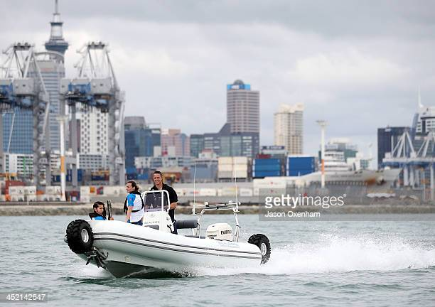 New Zealand Commonwealth Games athletes Joelle King and Nikki Hamblin and with Chef de Mission Rob Waddell behind the wheel during the arrival of the...