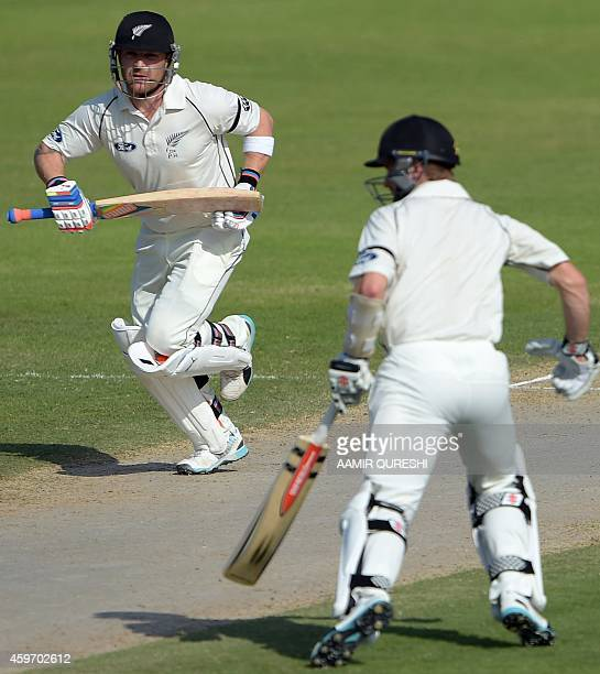 New Zealand cricket captain Brendon McCullum and teammate Kane Williamson run between wickets during the third day of the third and final Test match...