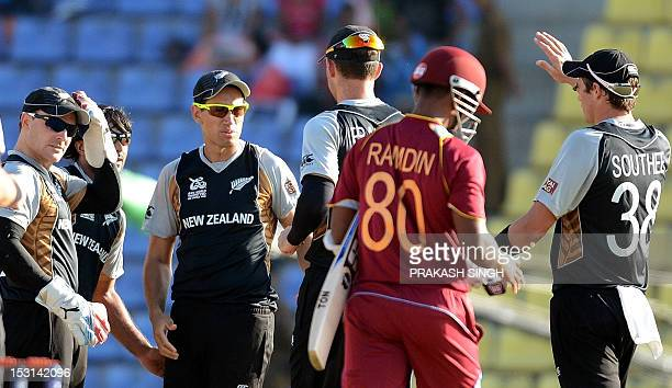 New Zealand cricket captain Ross Taylor celebrates the wicket of West Indies cricketer Denesh Ramdin with teammtes during the ICC Twenty20 Cricket...
