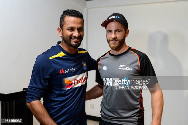 New Zealand cricket team captain Kane Williamson and his Sri Lankan counterpart Dimuth Karunaratne pose during a joint press conference at the Galle...
