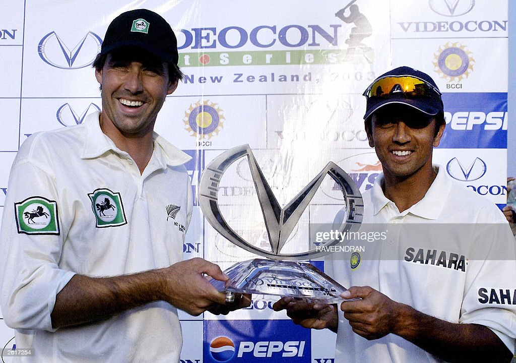 New Zealand cricket team captain Stephen Fleming and Indian captain Rahul Dravid hold the trophy at the end of the match on the fifth day of the...
