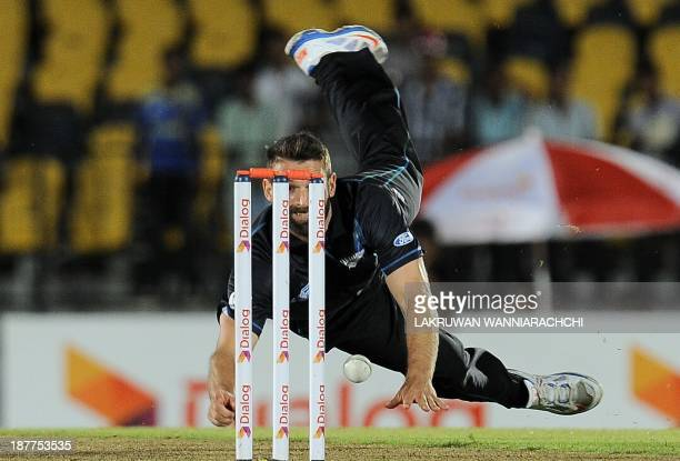 New Zealand cricketer Andrew Ellis makes an unsuccessful attempt to run out Sri Lankan batsman Tillakaratne Dilshan during the second One Day...