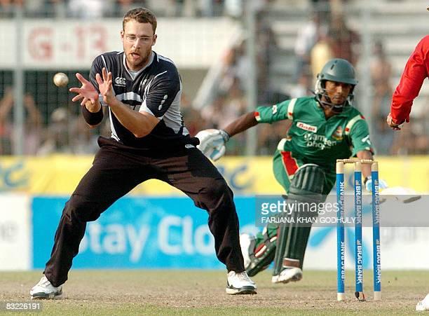 New Zealand cricketer Daniel Vettori receives a ball to run out Bangladeshi batsman Nayeem Islam during the second One Day International between...