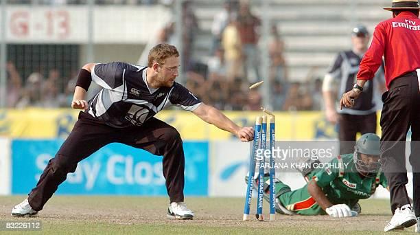 New Zealand cricketer Daniel Vettori runs out Bangladeshi batsman Nayeem Islam during the second One Day International between Bangladesh and New...