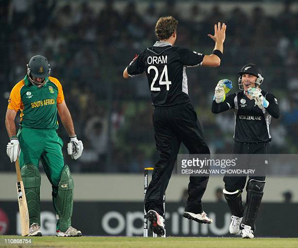 New Zealand cricketer Jacob Oram and Brendon McCullum celebrate the dismissal of South African batsman Graeme Smith during the quarterfinal match of...