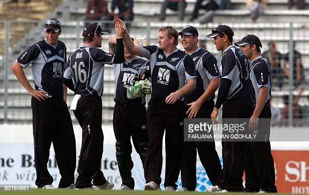 New Zealand cricketer Scott Styris celebrates the wicket of Bangladesh batsman Musfiqur Rahim with his team mates during the first One Day...