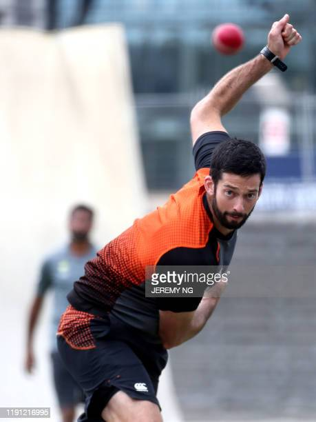 New Zealand cricketer William Somerville bowls during a training session on the eve of the third cricket Test match between Australia and New Zealand...