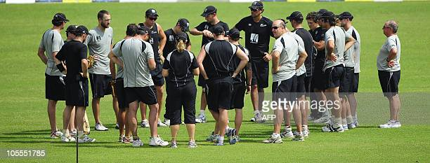 New Zealand cricketers and team officials gather for a briefing during a training session at the Shere Bangla national stadium in Dhaka on October 16...