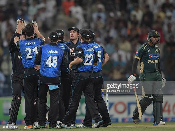 New Zealand cricketers celebrate after the dismissal of Pakistani batsman Nasir Jamshed during the fifth and final daynight international match...