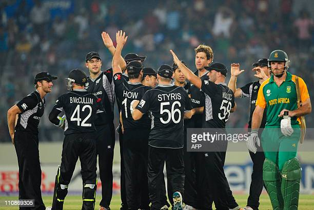 New Zealand cricketers celebrate after the dismissal of South African captain Graeme Smith during the quarterfinal match of the ICC Cricket World Cup...