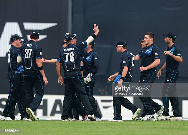 New Zealand cricketers celebrate the dismissal of Bangladesh batsman Ziaur Rahman during the third OneDay International cricket match between...