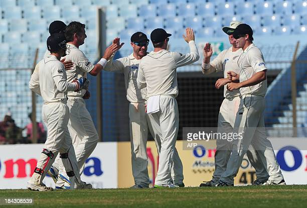 New Zealand cricketers celebrate the dismissal of Bangladeshi batsman Anamul Haque during the fifth and final day of the first cricket Test match...