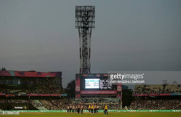 New Zealand cricketers walk off the ground after a floodlight failure during the World T20 cricket tournament match between Bangladesh and New...