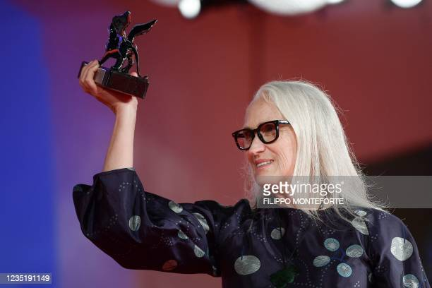 """New Zealand director Jane Campion poses with the Silver Lion for Best Director she received for """"The Power of the Dog"""" during the Winners' Photocall..."""