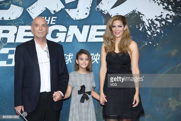 New Zealand director Martin Campbell with his wife and daughter arrives at the red carpet during the premiere of his film 'The Foreigner' on...