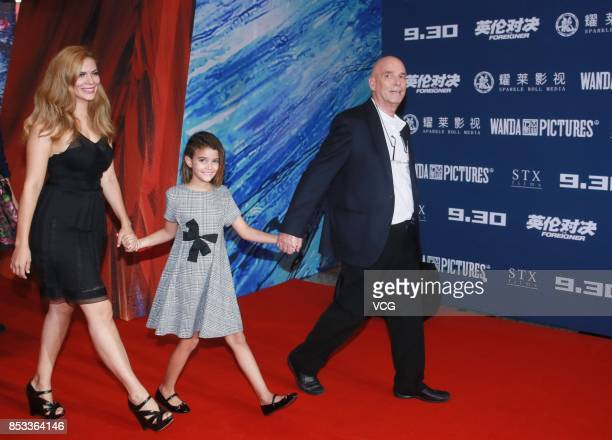 "New Zealand director Martin Campbell with his wife and daughter arrives at the red carpet during the premiere of his film ""The Foreigner"" on..."