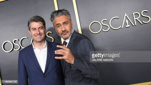 New Zealand director/actor Taika Waititi and producer Carthew Neal arrive for the 2020 Oscars Nominees Luncheon at the Dolby theatre in Hollywood on...