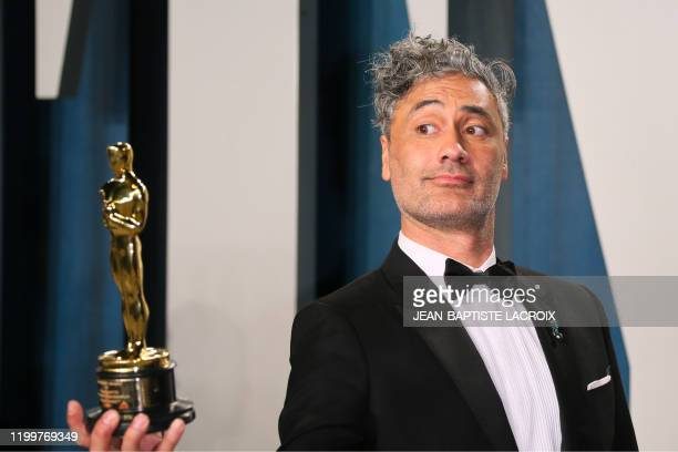 New Zealand directoractor Taika Waititi poses with his award for Best Adapted Screenplay for Jojo Rabbit as he attends the 2020 Vanity Fair Oscar...