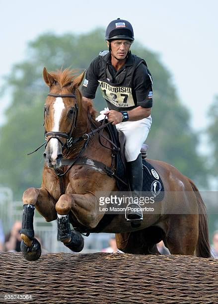 New Zealand equestrian Andrew Nicholson riding Nereo enters the lake complex during competition in the Cross Country Test section at the Mitsubishi...