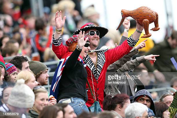 New Zealand fans celebrate during the match between New Zealand and Argentina during day two of the IRB Glasgow Sevens at Scotstoun Stadium on May 6...