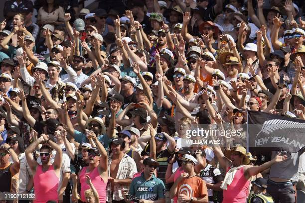 New Zealand fans cheers on their team as New Zealand loses to Australia on the fourth day of the second cricket Test match at the MCG in Melbourne on...