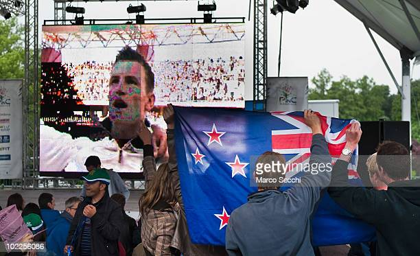 New Zealand fans hold up a national flag at Castello Sforzesco just before kick off of New Zealand's match against Italy on June 20, 2010 in Milan,...