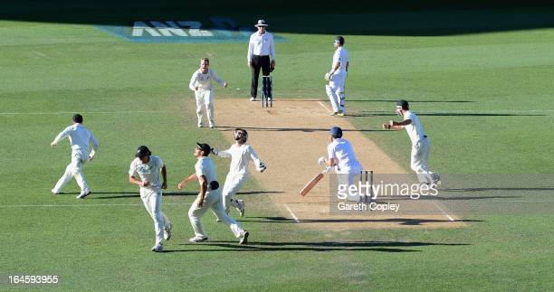 New Zealand fielder celebrate after Dean Brownlie catches out England captain Alastair Cook from the bowling of Kane Williamson during day four of...
