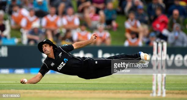 New Zealand fielder Colin de Grandhomme dives to catch out England batsman Joe Root during the 2nd ODI between New Zealand and England at Bay Oval on...