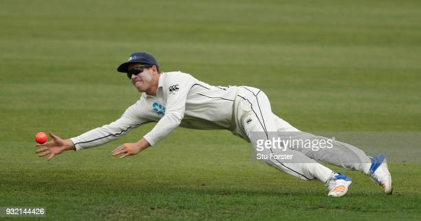 New Zealand fielder Henry Nicholls makes a diving stop during day two of the Test warm up match between England and New Zealand Cricket XI at Seddon...