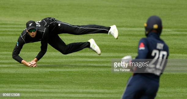 New Zealand fielder Mitchell Santner fields a ball from a Jason Roy shot during the 3rd ODI between New Zealand and England at Westpac stadium on...