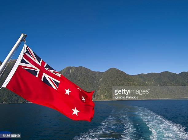 new zealand flag and mildford sound - new zealand flag stock photos and pictures