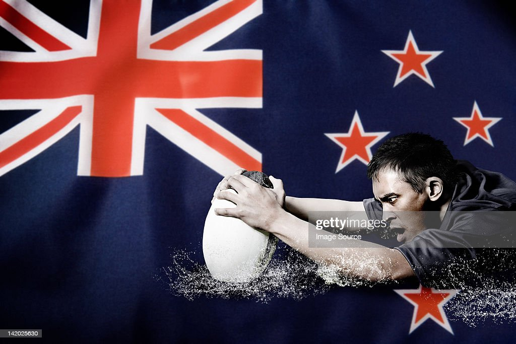 New Zealand flag and rugby player : Stock Photo