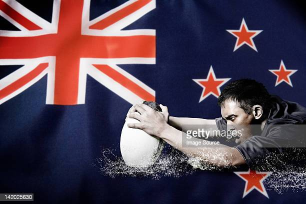 new zealand flag and rugby player - new zealand rugby stock photos and pictures