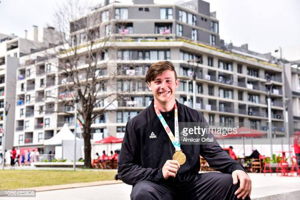 New Zealand flag bearer for the Closing Ceremony Connor Bell poses during an exclusive photo shoot with New Zealand medal winner on day 12 of Buenos...