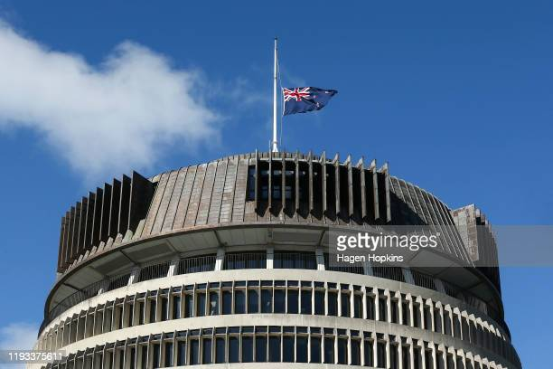 New Zealand flag flies at half-staff on top of the Beehive at Parliament on December 12, 2019 in Wellington, New Zealand. Five people are confirmed...