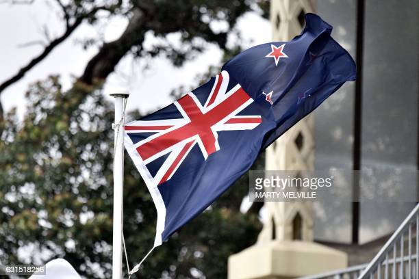 A New Zealand flag flutters in high winds during day one of the first international Test cricket match between New Zealand and Bangladesh at the...