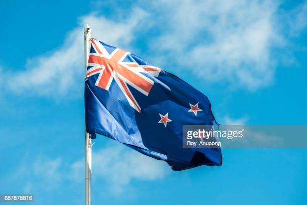 new zealand flag the symbol flag of new zealand. - flag stock pictures, royalty-free photos & images